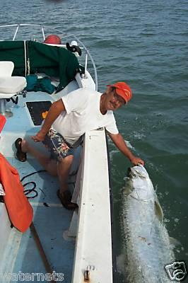 Capt Jay Masters with a 175 lb Tarpon release.